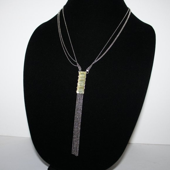 Pretty long silver and yellow gem necklace